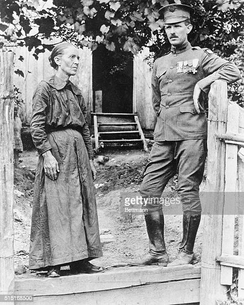 In front of his humble home in the hills of Tennessee Sergeant Alvin Cullom York posed with his mother is shown after returning from the war The...