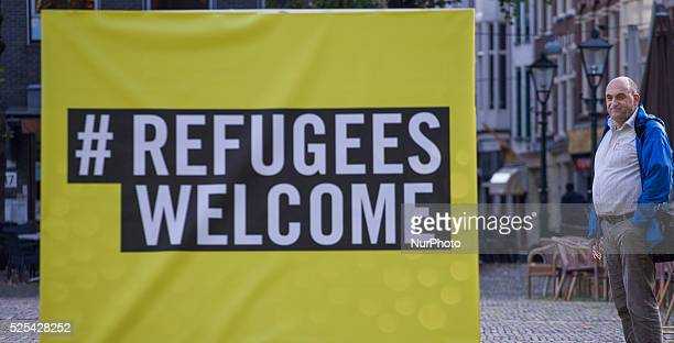 In front of parliament on Thursday Amnesty International laid out 400 doormats to draw attention to the refugee problem ahead of a debate on the...
