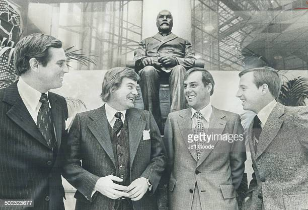 In front of statue of Timothy Eaton the store's founder the Eaton brothers discuss their store's future They're in the foyer of new Eaton Centre at...