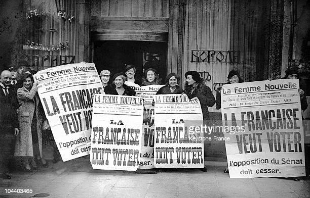 In front of the Grand Hotel in Paris women activists of the feminist association LA FEMME NOUVELLE brandished placards and signs to obtain the right...