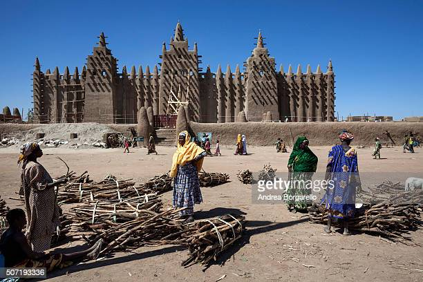 in front of the Great Mosque of Djenne on January 22 2010 in Djenne Mopti region Mali The Mosque is located in the old town of Djenné World Heritage...