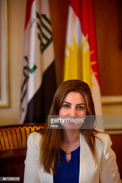 In front of the Iraqi and Kurdish flags portrait of Vian Dakhil the only Yezidi deputy of the Iraqi parliament during an official visit of Mrs Anne...