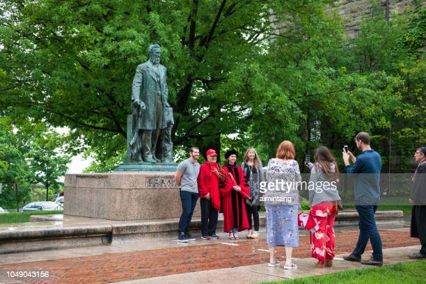 In front of the statue of Ezra Cornell in Cornell University