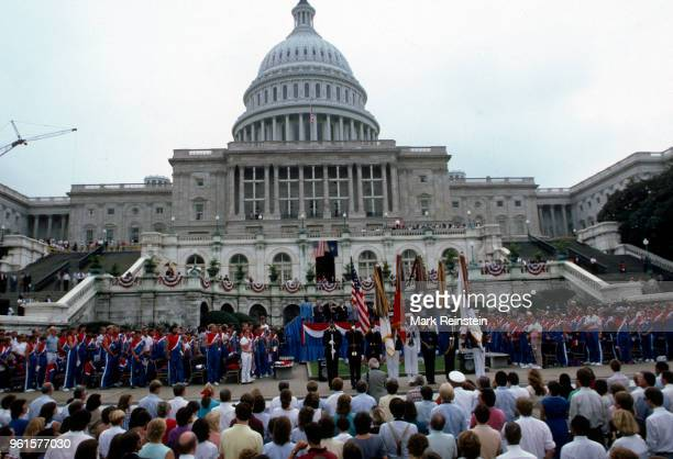 In front of the US Capitol an honor guard hold flags during an event to celebrate the United States Summer Olympic team Washington DC August 1984