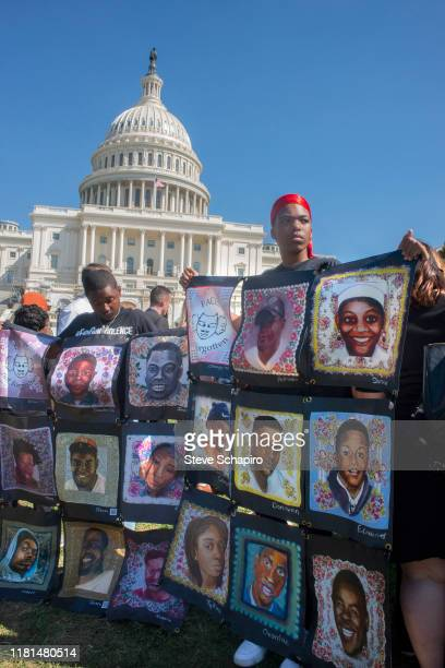 In front of the US Capitol building, Chicago-based demonstrators hold up images of victims of gun-related crimes, during an End Gun Violence rally,...