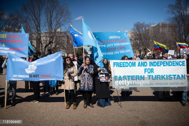 In front of the White House disasporic protestsors demand US support of the Ugyhur ethnic population in China's far west Xinjiang province which they...