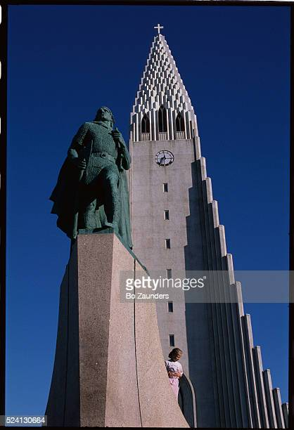 In front of this church built to mimic the flow of lava stands a statue of Leif Ericsson facing west