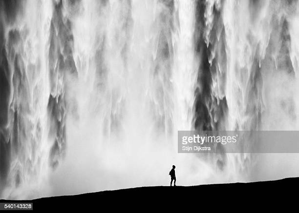 In front of waterfall silhouette