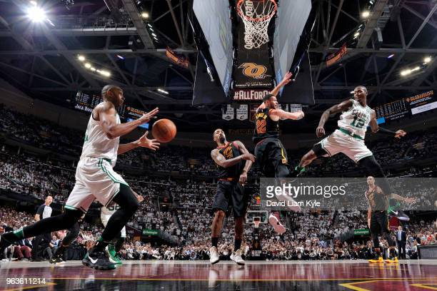 Terry Rozier passes the ball to Al Horford of the Boston Celtics against the Cleveland Cavaliers in Game Six of Eastern Conference Finals of the 2018...