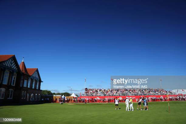 In Gee Chun of Korea Ariya Jatunugam of Thailand and Georgia Hall of England finish their rounds on the 18th green during the first round of the...