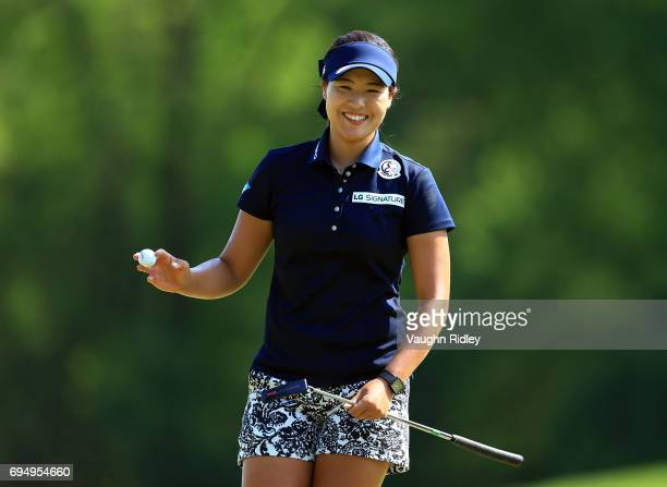 In Gee Chun of Korea reacts after sinking a putt on the 16th green during the final round of the Manulife LPGA Classic at Whistle Bear Golf Club on...