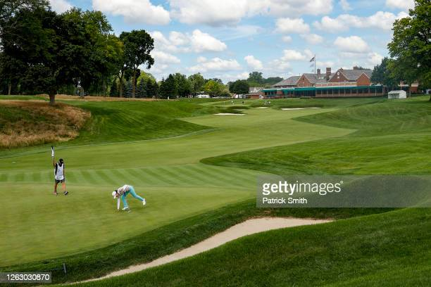 In Gee Chun of Korea retrieves her ball from the 15th hole as the tournament is played without spectators due to the COVID-19 pandemic during the...