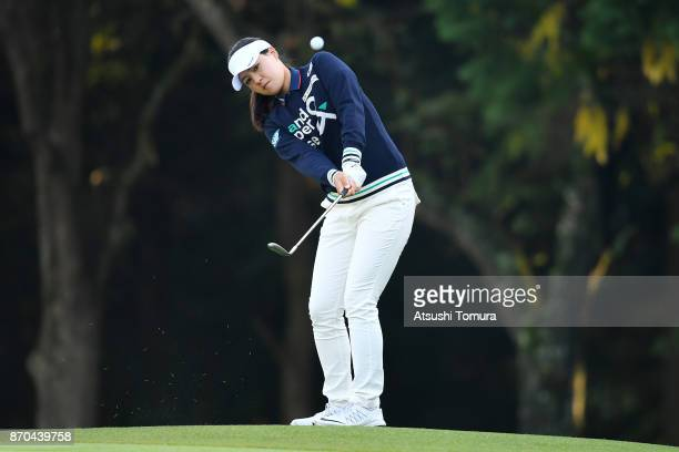 In Gee Chun of South Korea chips onto the 1st green during the final round of the TOTO Japan Classics 2017 at the Taiheiyo Club Minori Course on...