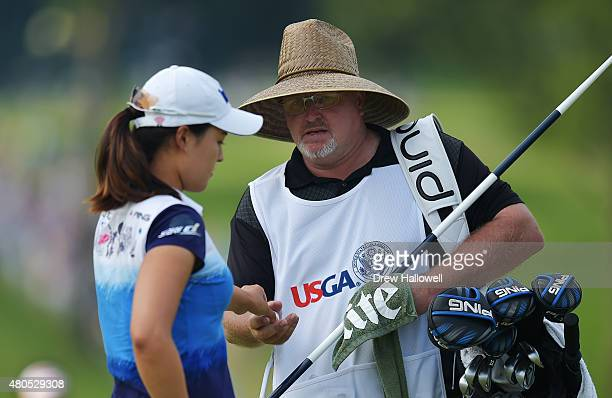 In Gee Chun of South Korea hands her ball to her caddie Dean Herden on the 18th hole during the final round of the U.S. Women's Open at Lancaster...