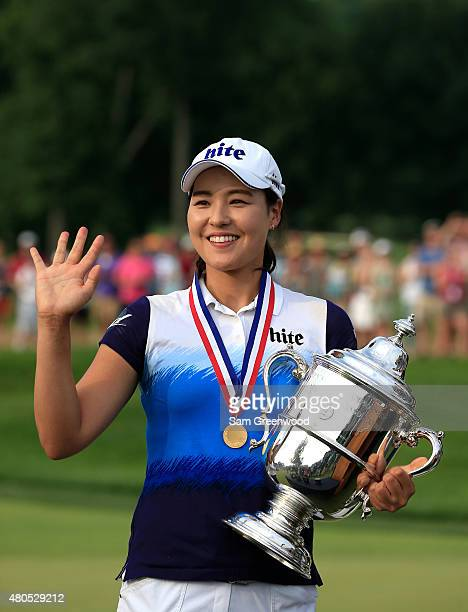In Gee Chun of South Korea poses with the trophy after winning the U.S. Women's Open at Lancaster Country Club on July 12, 2015 in Lancaster,...