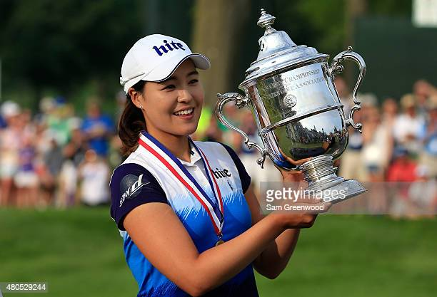 In Gee Chun of South Korea poses with the trophy after winning the US Women's Open at Lancaster Country Club on July 12 2015 in Lancaster Pennsylvania