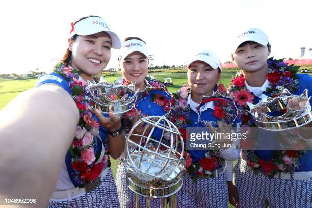 In Gee Chun, So Yoen Ryu, In-Kyung Kim and Sung Hyun Park of South Korea pose for photographs with the trophy after winning the UL International...