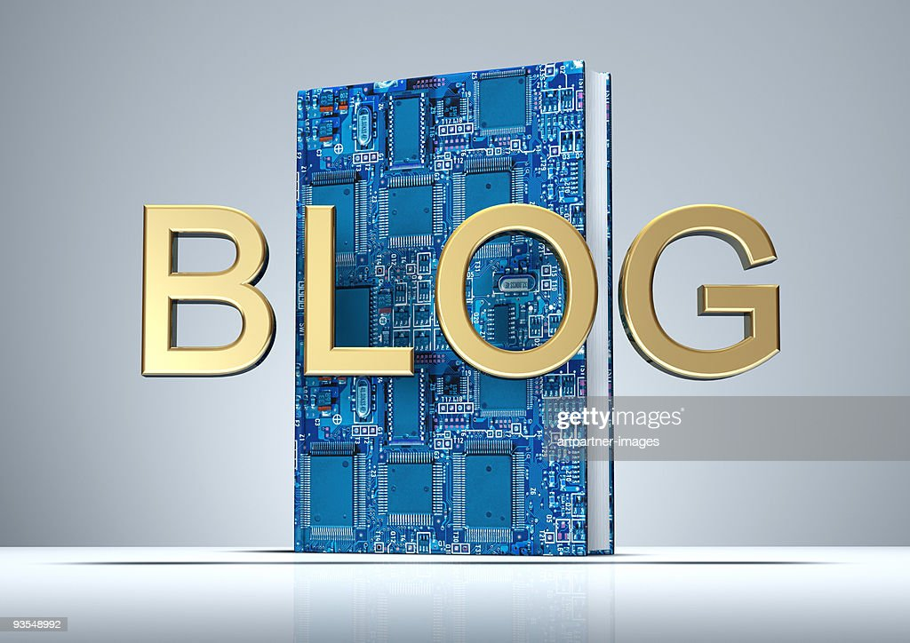 BLOG in golden letters with Digital Book : 圖庫照片