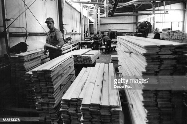 In Great Scot's plant near Bayfield Colo aspen is made into planking for coasttocoast shipment Plant's manager is Jim Holt native of area Credit...