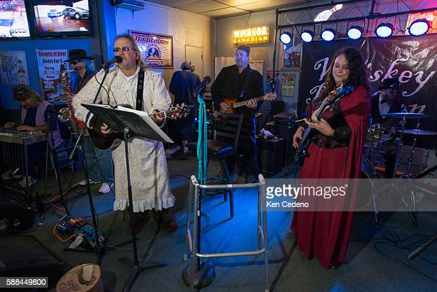 In Halloween costumes the Big Bad Wolf and Little Miss Riding Hood jam with the band Whiskey Rebellion at a local bar The Sports Den in Williston ND...