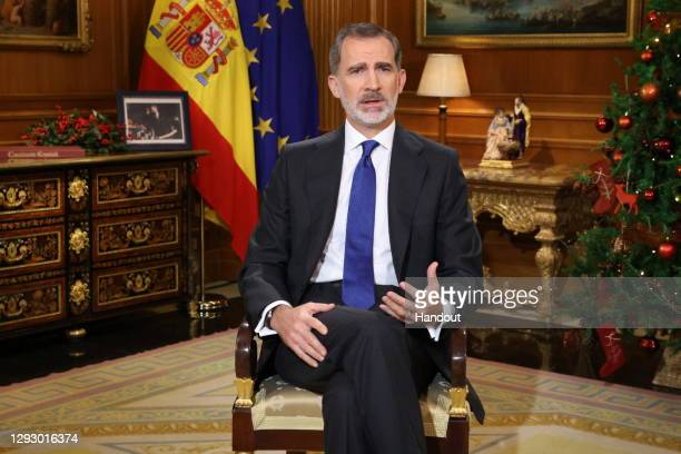 In handout image provided by the Spanish Royal Household, King Felipe of Spain is seen delivering the traditional Christmas speech at the Royal House...