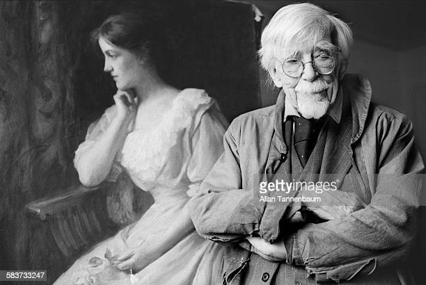 In his Chelsea Hotel studio centenarian artist AP Cole poses with his portrait of his late wife New York New York January 11 1975