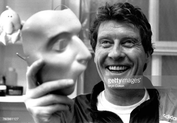 In his dressing room British actor Michael Crawford star of Andrew Lloyd Webber's musical 'Phantom of the Opera' holds the phantom mask during a...
