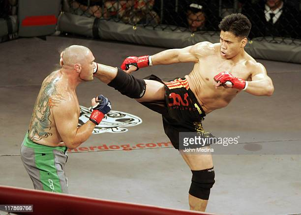 """In his MMA debut, Cung Le knocks out Mike Altman with a first-round kick during the """"StrikeForce"""" professional mixed martial arts event March 10,..."""
