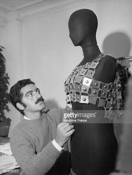 In His Studio Around 1968 The Creator Paco Rabanne Made Up Metal Pieces Which Were To Be Used In One Of His Creations Next To Him A Metal Dress Hangs...