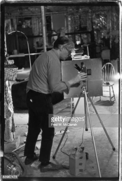 In his studio the Factory American pop artist Andy Warhol lines up a shot for his film 'Taylor Mead's Ass' New York New York September 5 1964