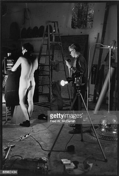 In his studio the Factory American pop artist Andy Warhol lines up a shot for his film 'Taylor Mead's Ass' which stars New York New York September 5...