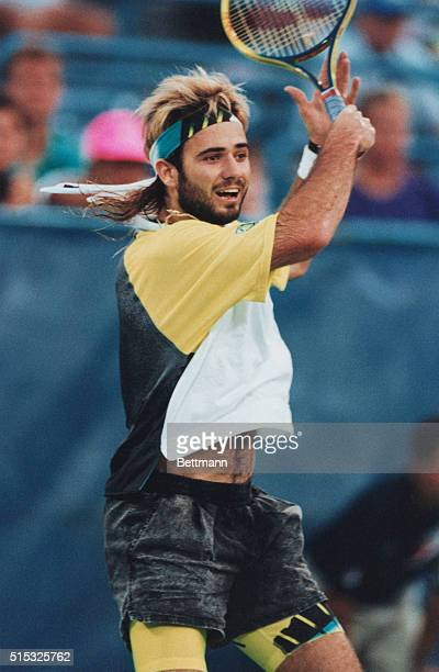 In his usual nontraditional tennis clothung Andre Agassi sporting a bread and longer hair in action at the US Open Photo by Jon Simon/Bettmann via...
