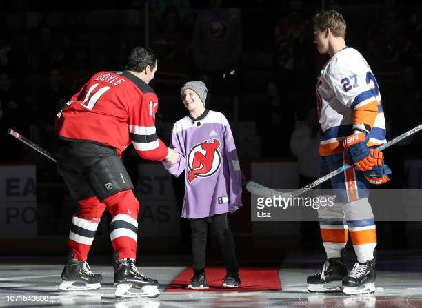 41b68cf79 In honor of Hockey Fights Cancer night survivor Bennett Burgida shakes  hands after the ceremonial puck