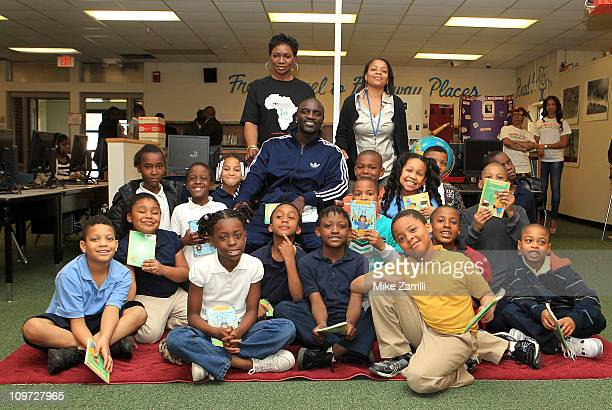 In honor of NEA's Read Across America Day Akon and his mother Kine Gueye Thiam President of the Konfidence Foundation visit second graders and...