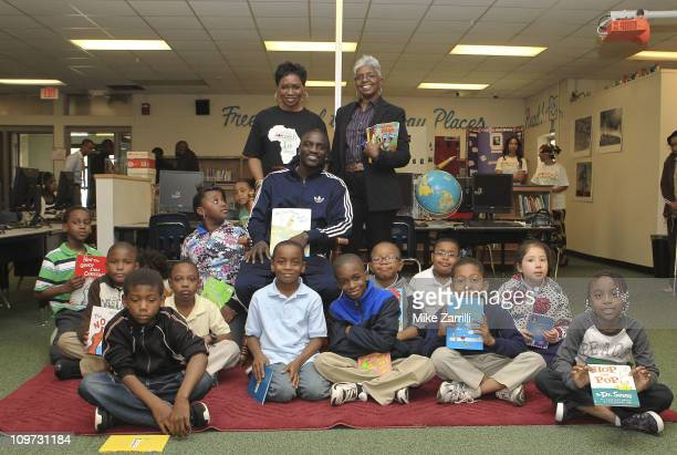 In honor of NEA's Read Across America Day Akon and his mother Kine Gueye Thiam President of the Konfidence Foundation visited second graders at Glen...