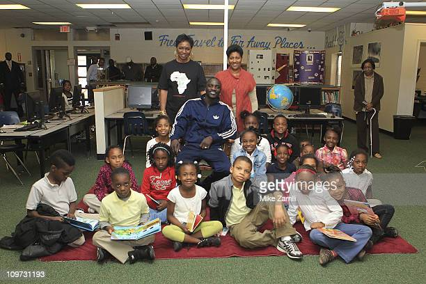 In honor of NEA's Read Across America Day Akon and his mother Kine Gueye Thiam President of the Konfidence Foundation visited second graders and...
