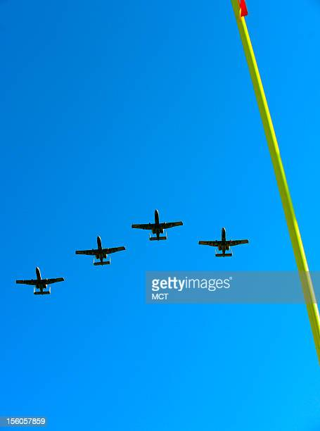 In honor of Veterans Day A10 attack jets fly over MT Bank Stadium in Baltimore before the Ravens take on the Oakland Raiders on Sunday November 11...