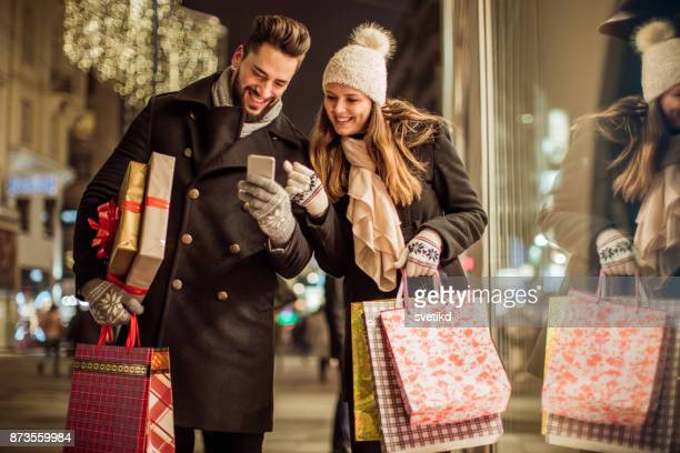 in hunt for perfect gifts - holiday shopping stock photos and pictures