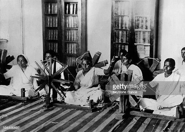 In India around 19201930 women make pieces of spun cotton or kadhi by using spinning wheels called chakras to boycott English merchandise
