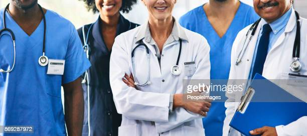 in it together for the good of you health - group of doctors stock pictures, royalty-free photos & images