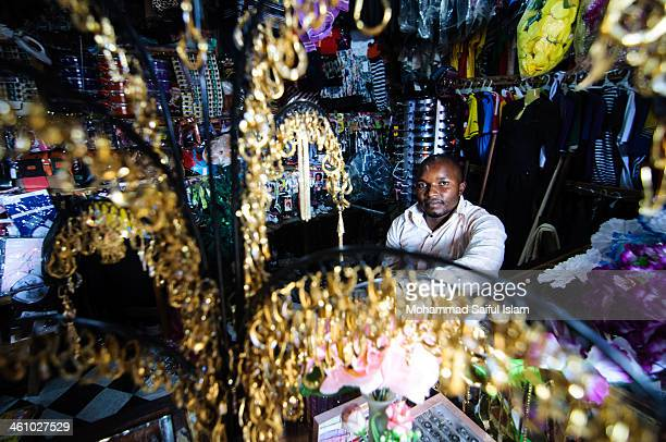 In Ituri District you hardly find any good shop for shopping. Yet, this was quite a good shop where this salesman was selling daily commodities and...