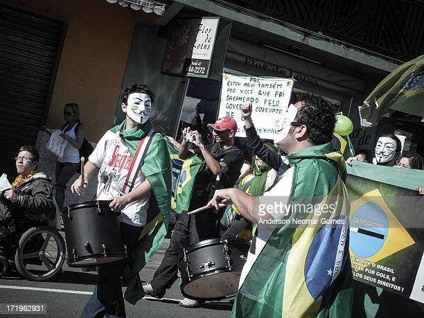 """In june 22 brazilians wearing anonymous masks were marching against laws that protects corrupted politicians in congress. """"Come to the streets!""""..."""