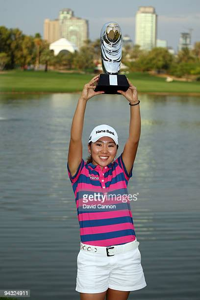 In Kyung Kim of South Korea holds the trophy after the final round of the Dubai Ladies Masters on the Majilis Course at the Emirates Golf Club on...