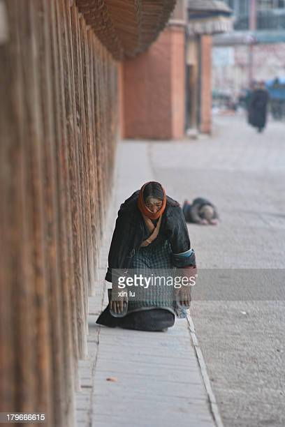 In Labrang Monastery temple early in the morning, the tibetans around the temple kowtow.