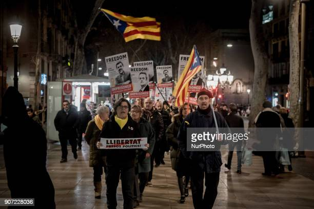 In Las Ramblas of Barcelona Catalonia Spain people march showing posters of imprisoned politicians and pro independentist leaders on 19 January 2018...