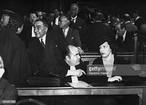 In late 1936 at the Paris courthouse Arlette STAVISKY the widow of the crook financier Alexandre STAVISKY attended the first session of her trial for...