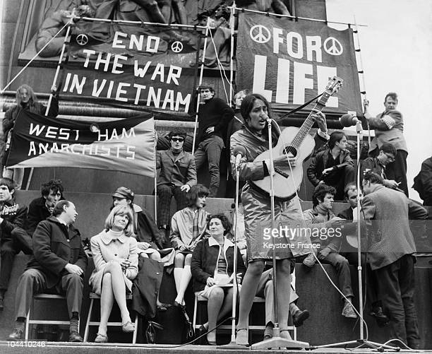 In London American singer Joan BAEZ playing and singing in Trafalgar Square during a protest organised against the war in Vietnam