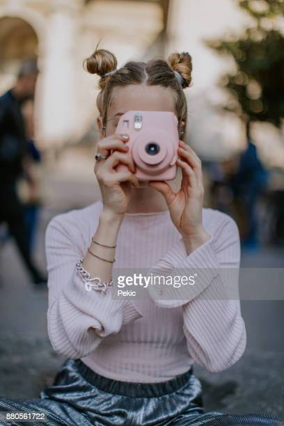 in love with pink colour and this instant camera - camera girls stock photos and pictures