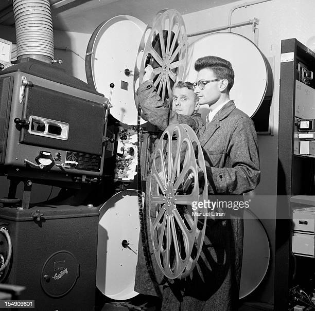 In May 1955 in the projection booth of a Parisian theater technicians preparing for a demonstration of a technique Cinerama shots using three...