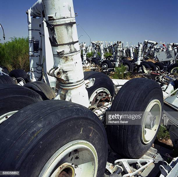In midday heat of the arid Arizona desert a complete set of main landing gear undercarriage stands upright amid a field of similar items from...